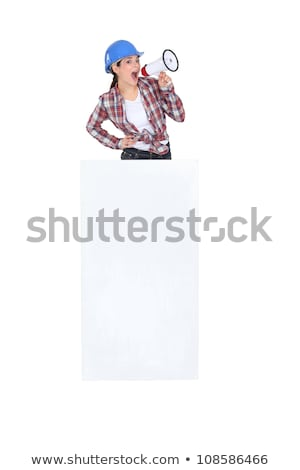 Tradeswoman yelling into a megaphone and standing behind a white sign Stock photo © photography33