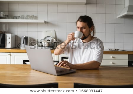Man using his laptop Stock photo © photography33