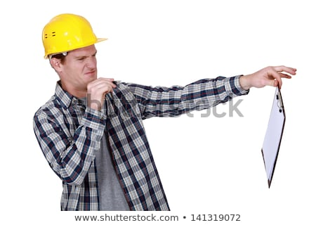Construction worker holding a distasteful clipboard Stock photo © photography33