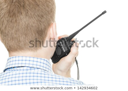 bodyguard communicating via walkie talkie stock photo © stockyimages
