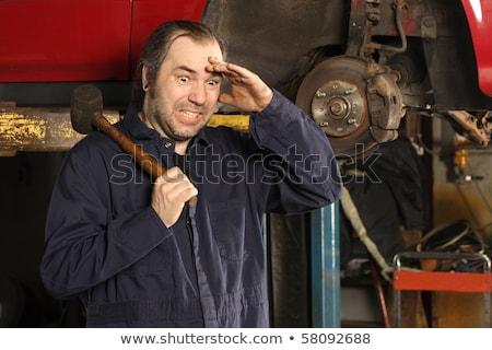 crazy mechanic fixing the brakes stock photo © sumners