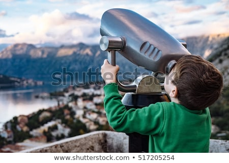 Tourist looking through a telescope Stock photo © photography33