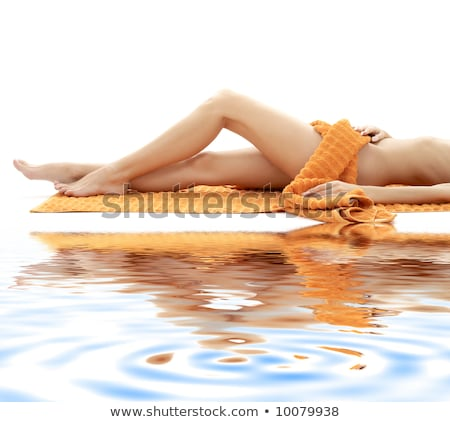 Hosszú lábak lány narancs törölköző fehér homok nyugodt Stock fotó © dolgachov