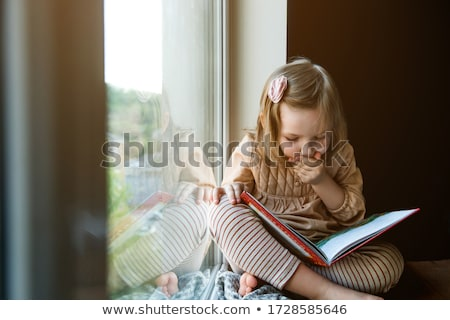 small child with a book Stock photo © jirkaejc