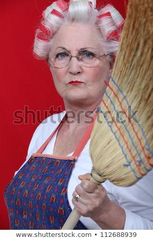Stern elderly lady holding broom Stock photo © photography33