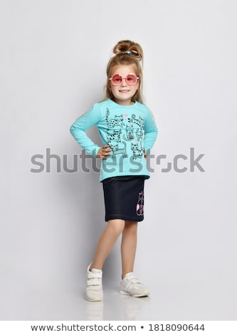 Stock photo: Playful young blonde in denim skirt