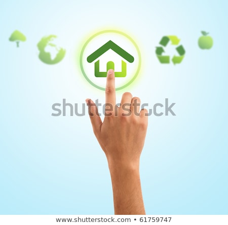 hand pressing home symbol from eco green icons Stock photo © ra2studio
