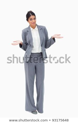 Saleswoman being clueless against a white background stock photo © wavebreak_media