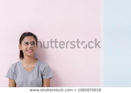 verwonderd · jonge · vrouw · naar · omhoog · Blauw · blouse - stockfoto © pablocalvog