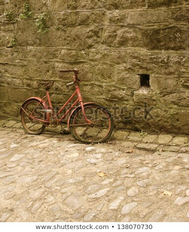 old child bicycle with cobble and wall  Stock photo © Melvin07