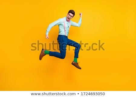 jóképű · ugrik · fickó · vicces · nyakkendő · férfi - stock fotó © konradbak