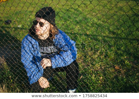 yakışıklı · adam · arkasında · çit · yakışıklı · adam · yüz - stok fotoğraf © konradbak
