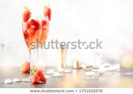 strawberry cocktail in a champagne flute stock photo © zerbor