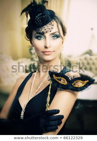 Beautiful woman in fancy dress in luxury interior. Stock photo © stepstock