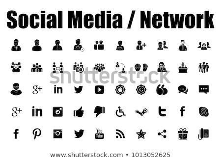 közösségi · média · mobiltelefon · kapcsolat · kéz · tart · ikonok - stock fotó © burakowski
