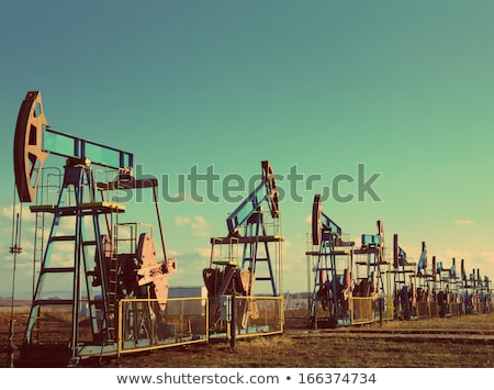 oil pumps silhouette   vintage retro style stock photo © mikko