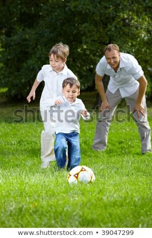 jonge · kaukasisch · jongen · spelen · tuin · blauwe · hemel - stockfoto © kzenon