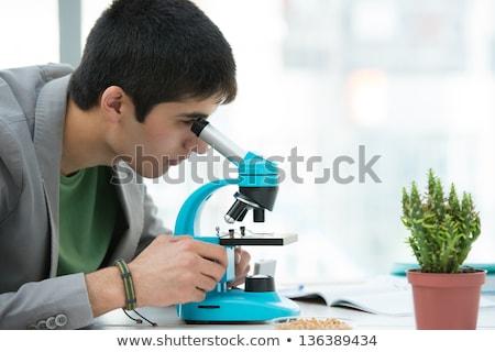 high school students young handsome male student peering throug stock photo © hasloo