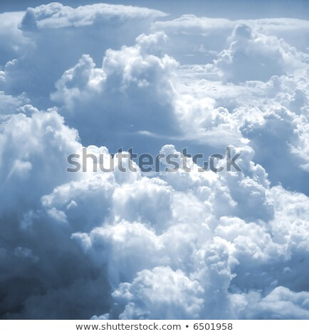 kind on clouds on a background a firmament from an airplane with Stock photo © meinzahn