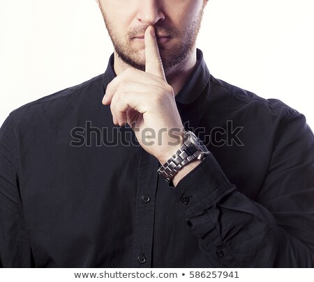 bearded business man with finger at mouth Stock photo © feedough