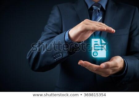 businessman - secret document Stock photo © dgilder
