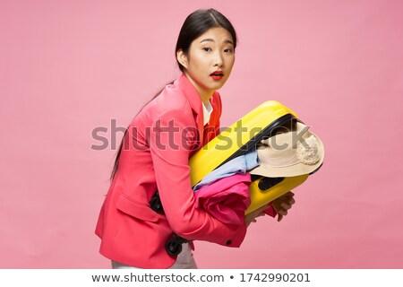 Woman unzipping shorts. Stock photo © iofoto