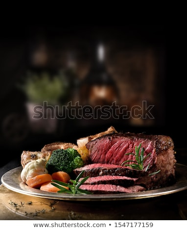 Stock photo: Succulent medium rare beef steak