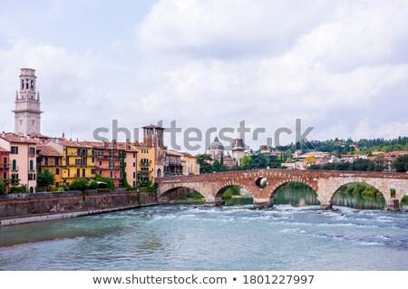 Ancient Roman Bridge called Ponte di Pietra in Verona Stock photo © marco_rubino