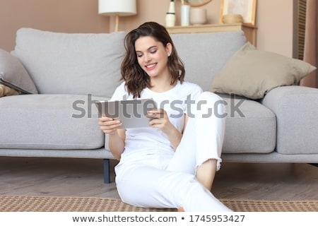 peinzend · jonge · vrouw · vergadering · sofa · laptop · portret - stockfoto © deandrobot