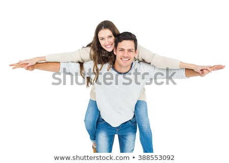 Young man giving a piggy back to his girlfriend Stock photo © Witthaya