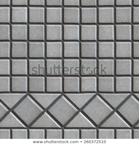 grey pave slabs in the form of small squares and triangles stock photo © tashatuvango