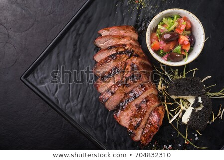 Stock photo: Serving of delicious medium rare sliced steak