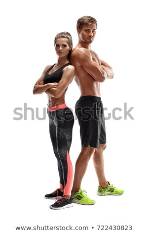 Portrait of a sporty couple with arms crossed Stock photo © wavebreak_media