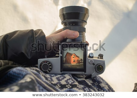 Man taking picture with vintage film camera Stock photo © stevanovicigor