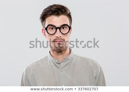 portrait of handsome confident student in black round glasses stock photo © deandrobot