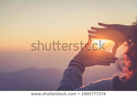 woman making frame with her hands stock photo © wavebreak_media