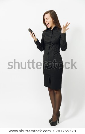 Worried disturbed young woman talking on mobile phone Stock photo © deandrobot