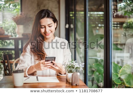 Woman using smart phone and laptop stock photo © punsayaporn