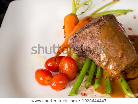 bbq steak barbecue grilled beef steak meat with red barbecue sa stock photo © dashapetrenko