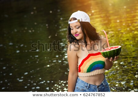 cropped image of a girl holding cocktail wearing bikini stock photo © deandrobot