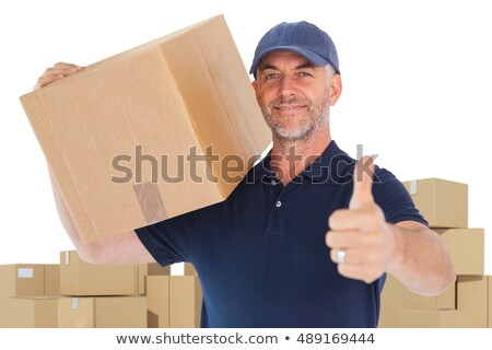 Composite image of delivery man with cardboard box gesturing thumbs up Stock photo © wavebreak_media