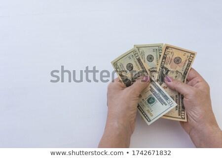 Felső kilátás női kezek dollár bankjegyek Stock fotó © stevanovicigor