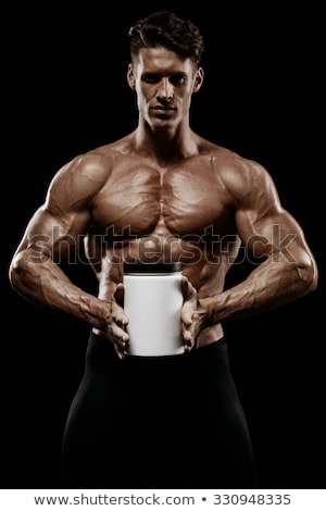 Stock photo: Muscular man with protein jars on white