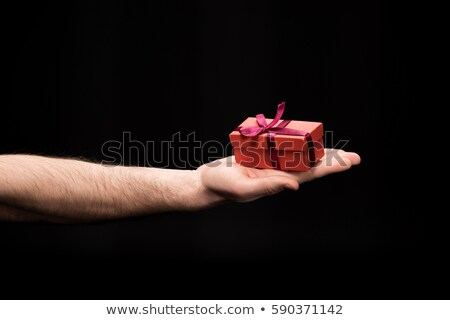 partial view of man showing gift box in hand on black, international womens day concept Stock photo © LightFieldStudios