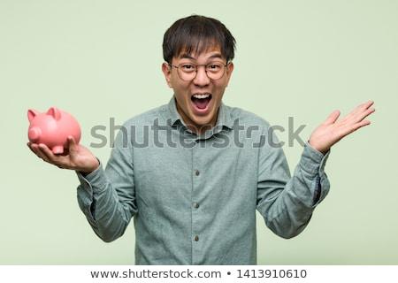 ázsiai üzletember tart persely mosolyog rózsaszín Stock fotó © RAStudio