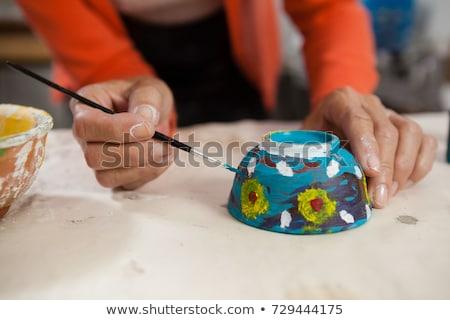 Femme apprentissage poterie classe homme Photo stock © wavebreak_media