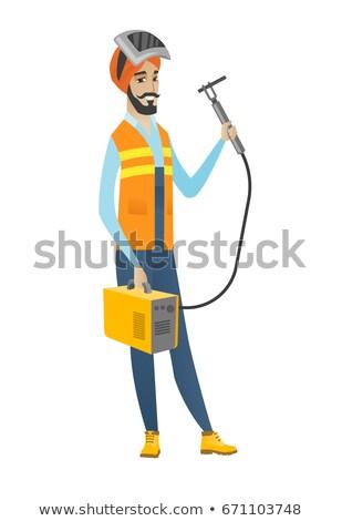 Young hindu welder holding gas welding machine. Stock photo © RAStudio