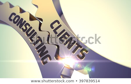 Clients Consulting on Golden Gears. Stock photo © tashatuvango