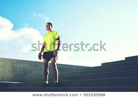 Portré izzadt afrikai futó pihen edzés Stock fotó © deandrobot