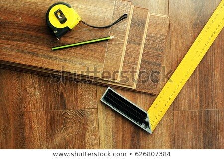 Laminate floor planks and tools on wooden background. Top view. Stock photo © Virgin